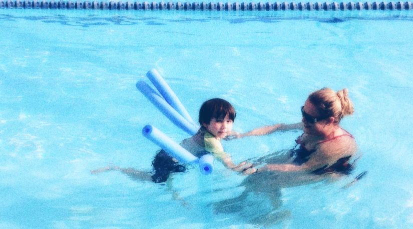 Simon with his instructor, Ms. Robin, at swim class.